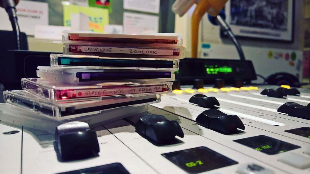 Stack of minidiscs sitting on a radio mixing desk
