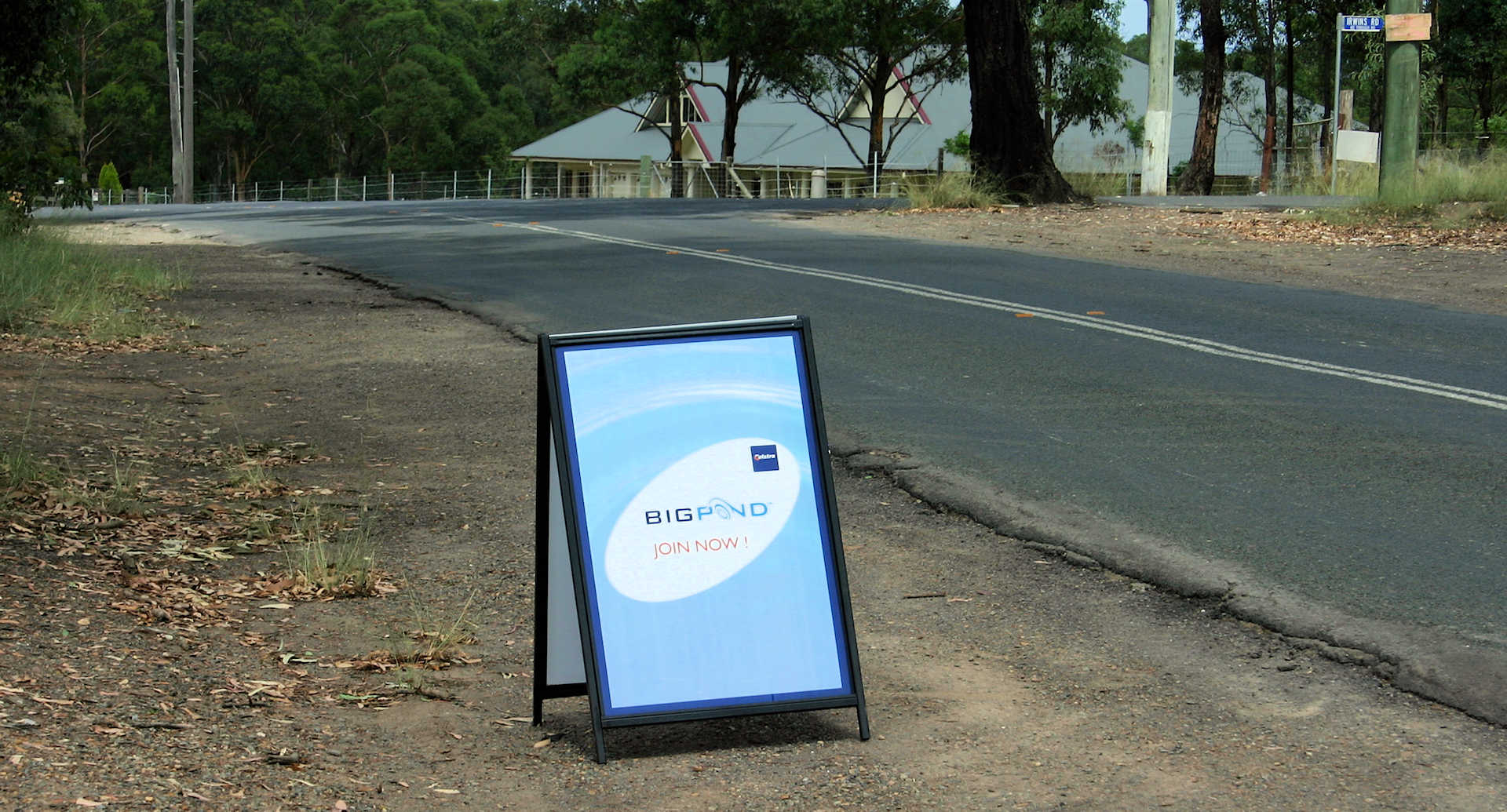 Sandwich board advertising the arrival of Telstra Bigpond ADSL in East Kurrajong